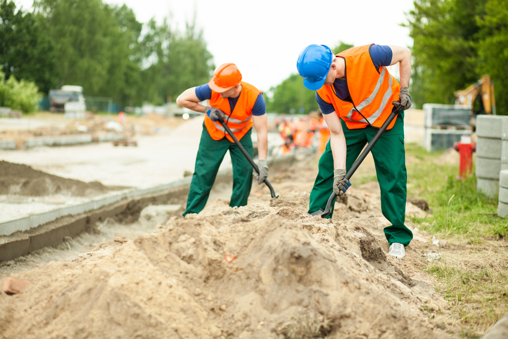 Image of construction workers digging on a road